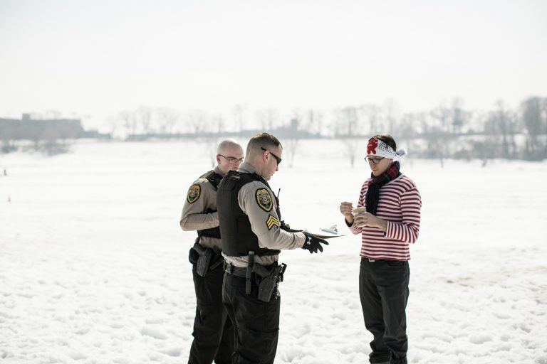 Park rangers verify special event permit for Frostbites Cafe popup restaurant on frozen Lake Erie