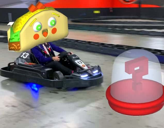 Go-kart racer in augmented reality game drives towards holographic power-up